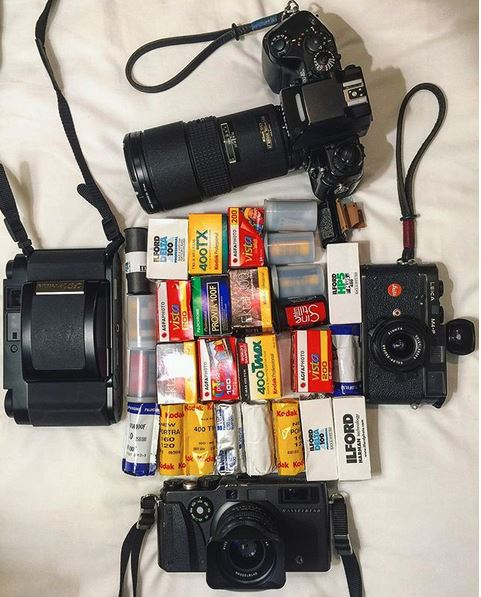 Negative to digital scan - picture of film cameras and rolls of film